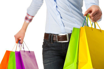 Woman holding multicolored shopping paper bags