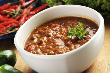 bowl of red hot chili with ground beef, beans and legumes.