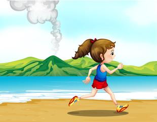 A girl jogging at the seashore