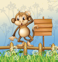 A monkey standing in a fence beside an empty board