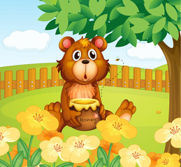 A bear inside the wooden fence