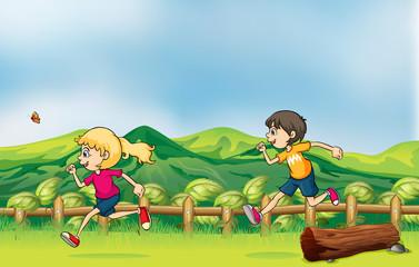 Zelfklevend Fotobehang Vlinders A boy and a girl jogging
