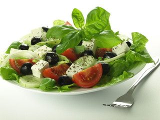 Greek salad with basil leaves