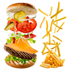 Fastfood - hamburger and french fries, flying ingrediens
