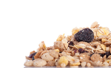 a pile of muesli on a white background