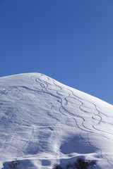 Off-piste slope with trace of skis on snow