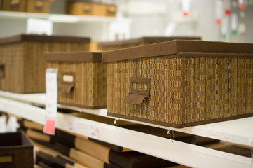 Artistic boxes for goods on shelf in supermarket
