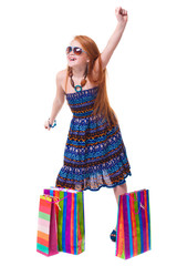 Happy fashion little redhead girl with shopping bags