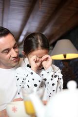Man comforting his daughter