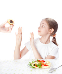 girl refuses cake and chooses salad