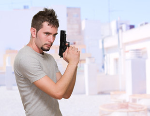 concentrated man holding gun