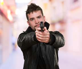 portrait of a man pointing with a gun