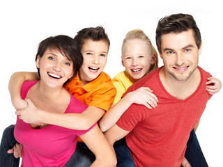 Wall Mural - Happy family with two children on white
