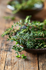 Bunch of fresh thyme in a ceramic dish