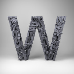 Letter W made out of scrambled small letters in studio setting