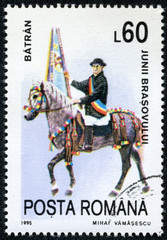 stamp showing celebrating man riding horse