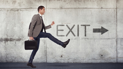 Young businessman going to the exit Wall mural