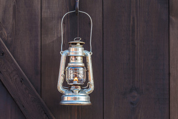 Old fashioned lantern on an wooden wall