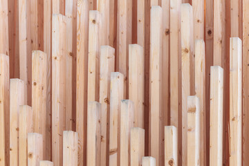 Vertical row of new wooden planks