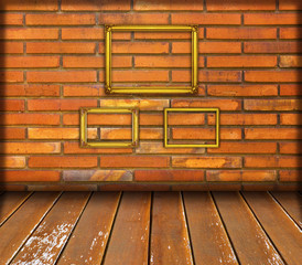 Gold frame on old red brick wall