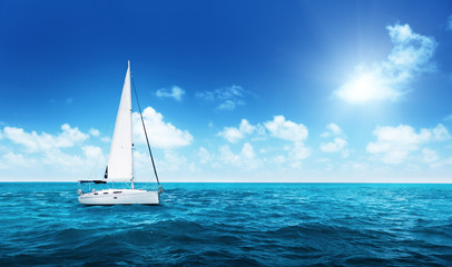 Yacht Sailing on water of ocean