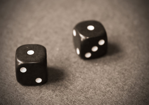 Black dice rolling 2 one's - snake eyes