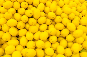 Colorful Display Of Lemons In A Market
