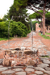 Fototapete - Well on old roman stony street at Ostia Antica - Rome