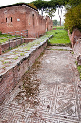 Fototapete - Mosaic and baths building ruins in Ostia Antica