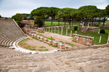 Fototapete - Amphitheatre steps and mausoleum in Ostia antica - Rome