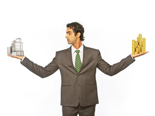 Business man balancing coin and building