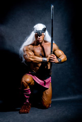 Muscular man warrior with white long hair holding a sword