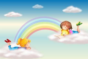 Aluminium Prints Rainbow Two girls along the rainbow