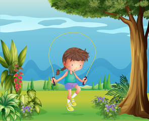 A girl playing jumping rope near the tree