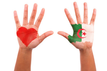 African hands with a painted heart and algerian flag, i love alg