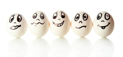 Eggs with funny faces isolated on white