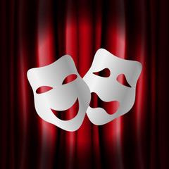 Theater masks with red curtain