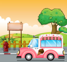 A pink ice cream bus and an empty board