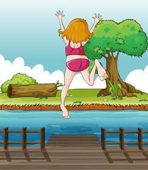 Canvas Prints River, lake A girl jumping at the wooden bridge