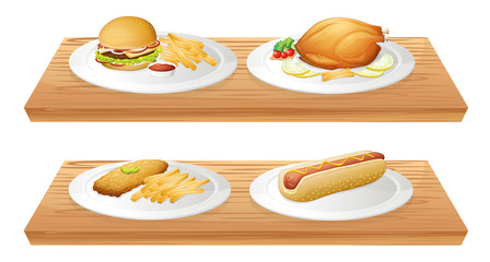 Wooden trays with plates of foods