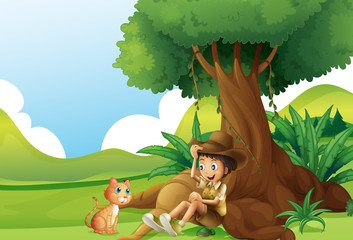 Deurstickers Katten A young boy and a cat under the big tree