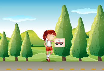 A young girl with a picture of a vehicle
