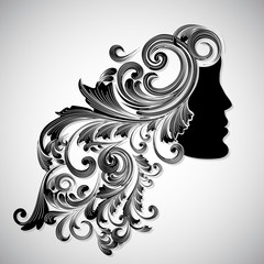 Silhouette of a beautiful girl with floral decorated hairs for H