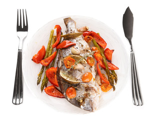Roasted gilt-head bream with vegetables on plate, isolated on wh