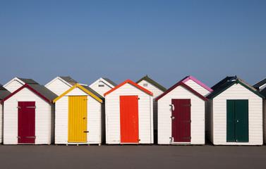 Colorful Beach Huts at Paignton, Devon, UK.