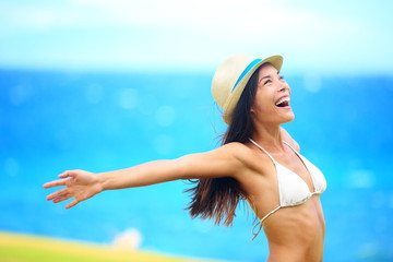 Wall Mural - Freedom - free young woman happy on beach