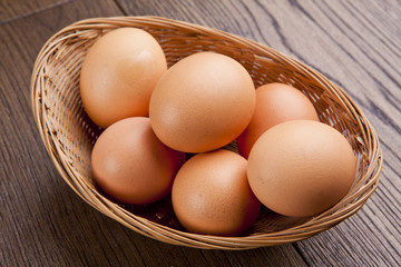 eggs in a bascket on wooden table