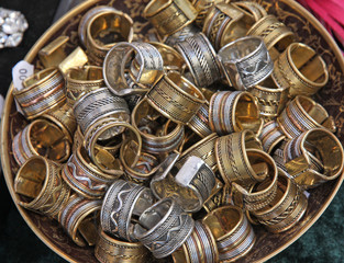 metal pile ethnic rings sold at local market