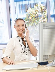 Happy office girl with headset