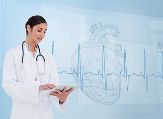 Cheerful cardiologist using a tablet pc